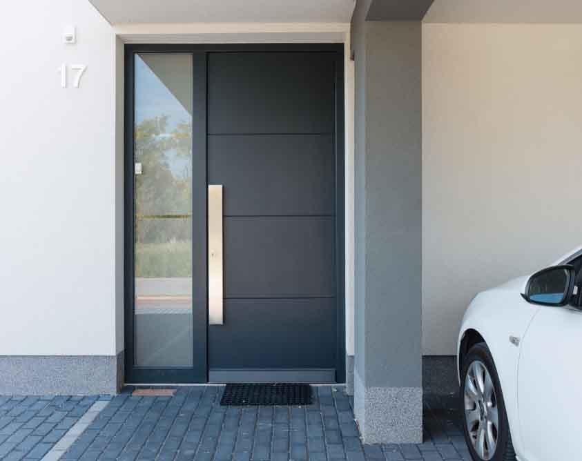 grey composite door on a modern home