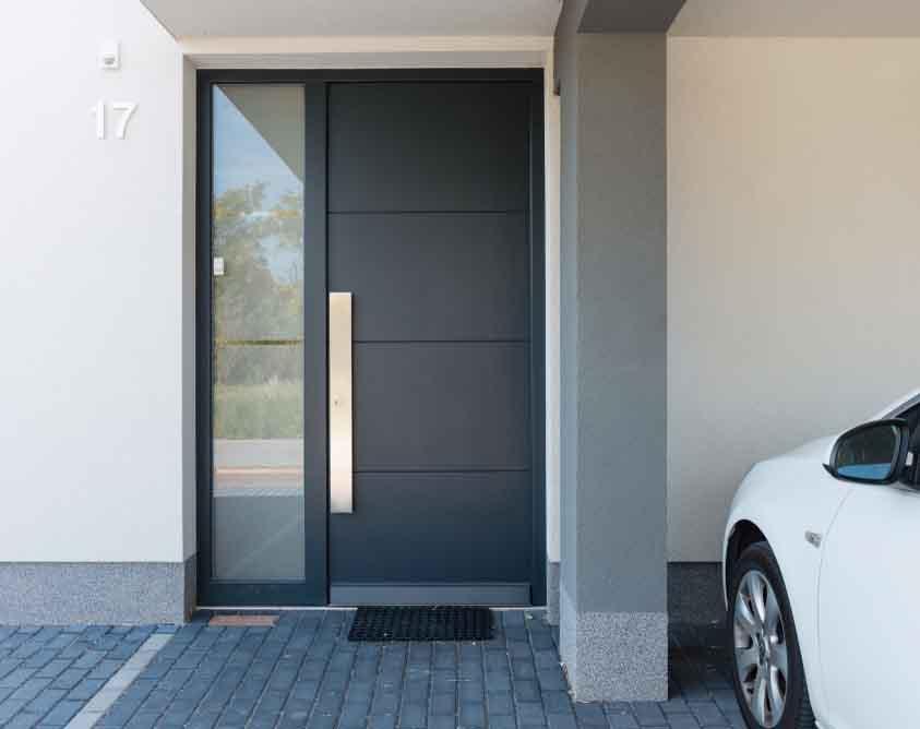 grey composite door on a modern home